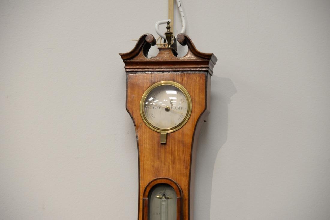 Satinwood wheel barometer.  height 38 in. - 4