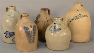 Group of five stoneware jugs, Whites Utica two gallon