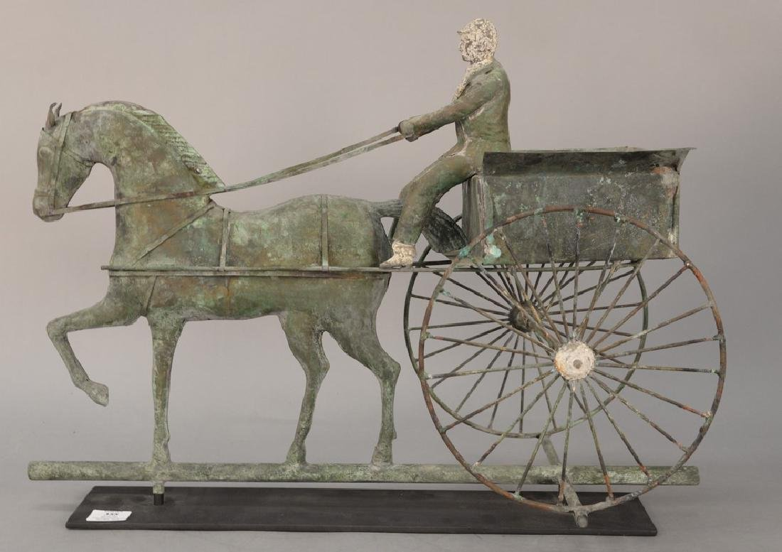 Copper weathervane, horse drawn wagon with rider having