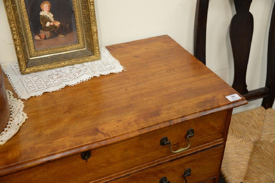 Chippendale four drawer chest on bracket feet.  height - 3
