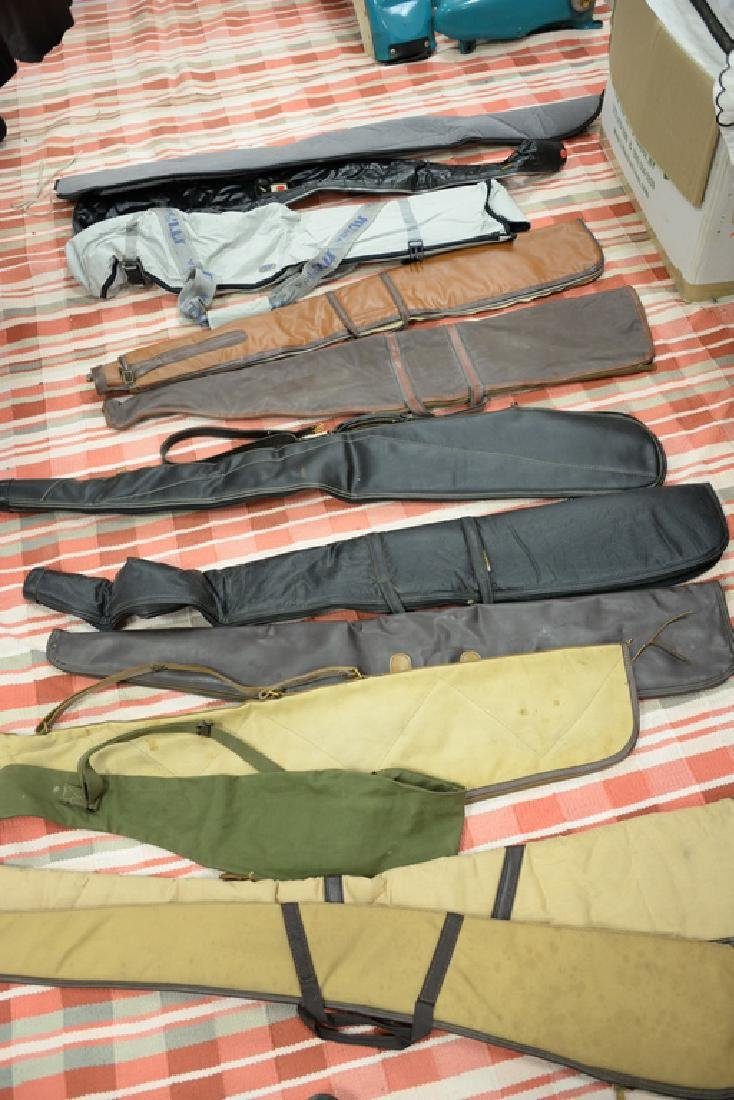 Large group of gun, rifle, and shotgun cases.