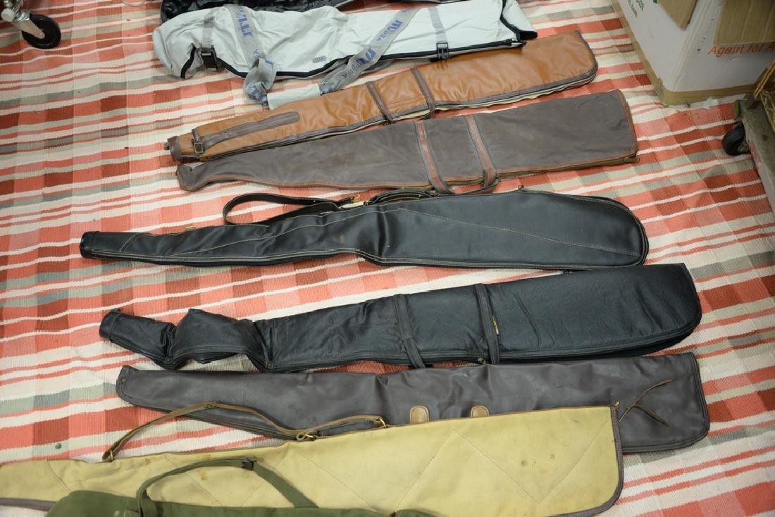 Large group of gun, rifle, and shotgun cases. - 3