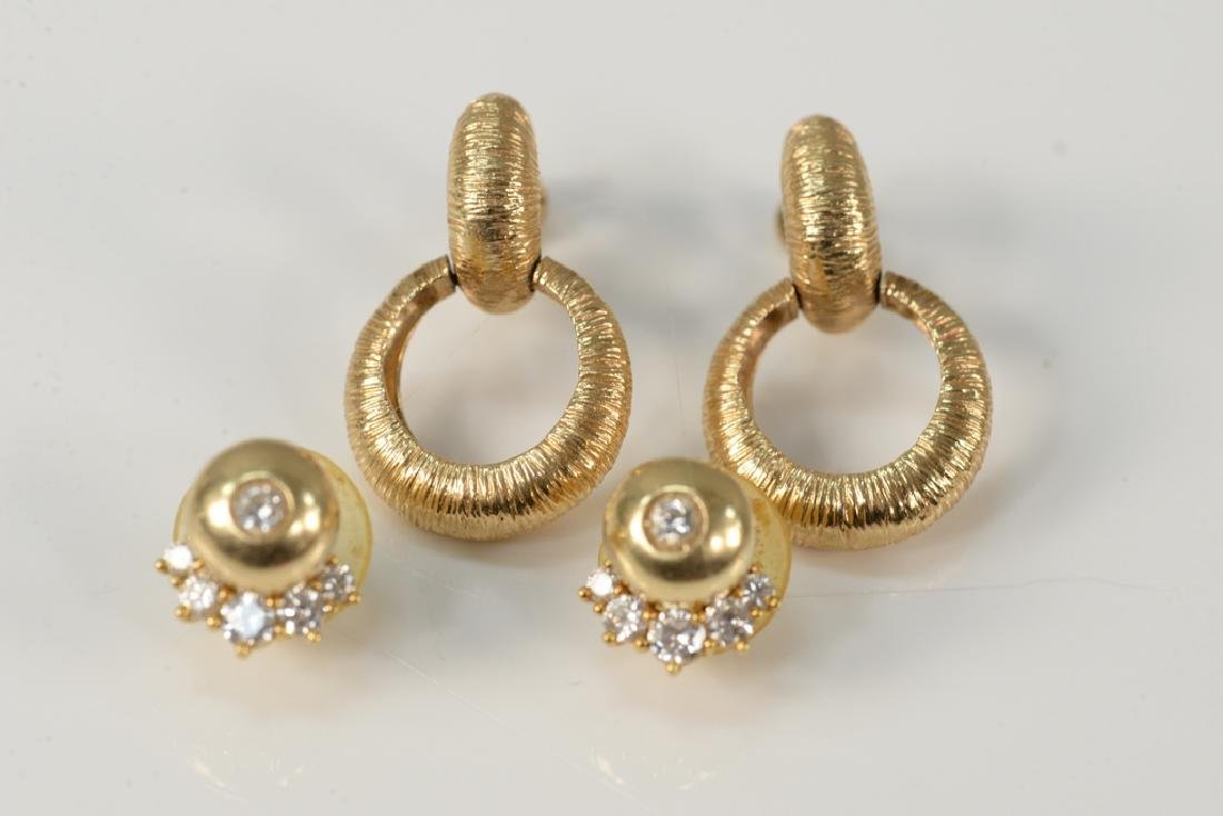 Two pairs of 14 karat gold ear clips to include a