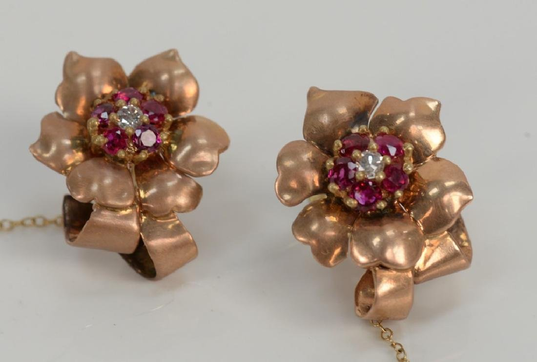 14 karat pink gold earrings, set with five rubies and