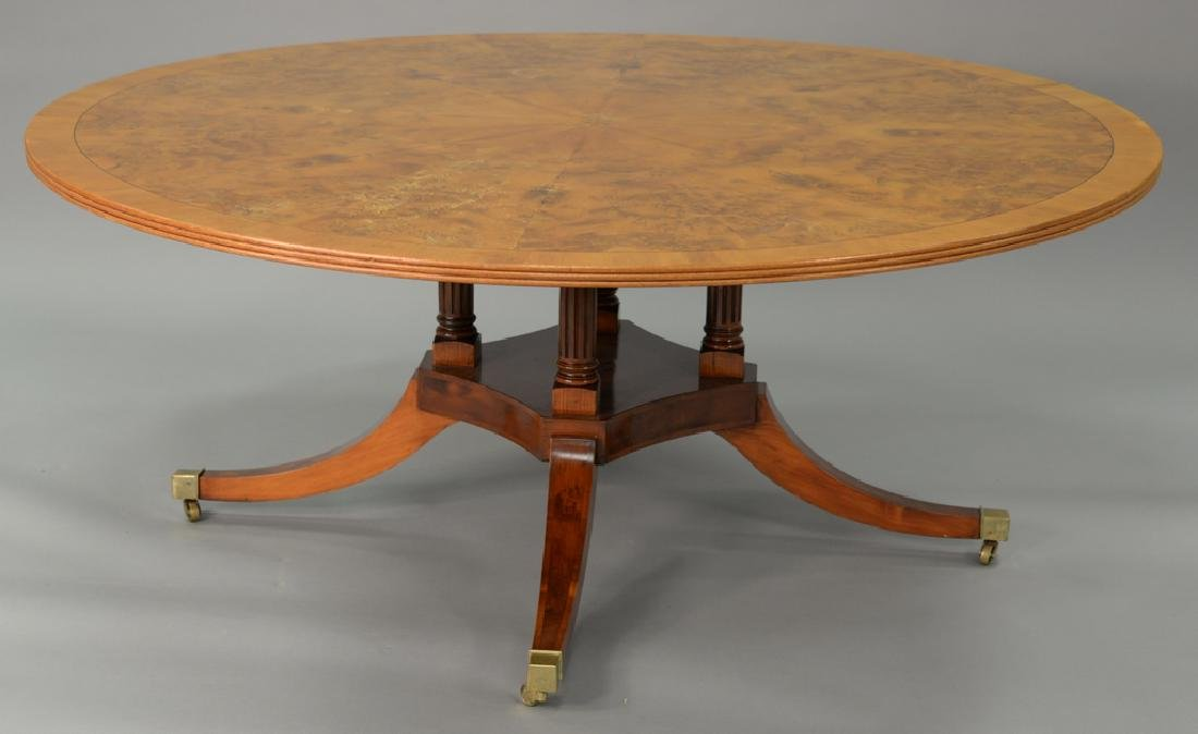 Round pedestal dining table with pads. ht. 29 in., dia.