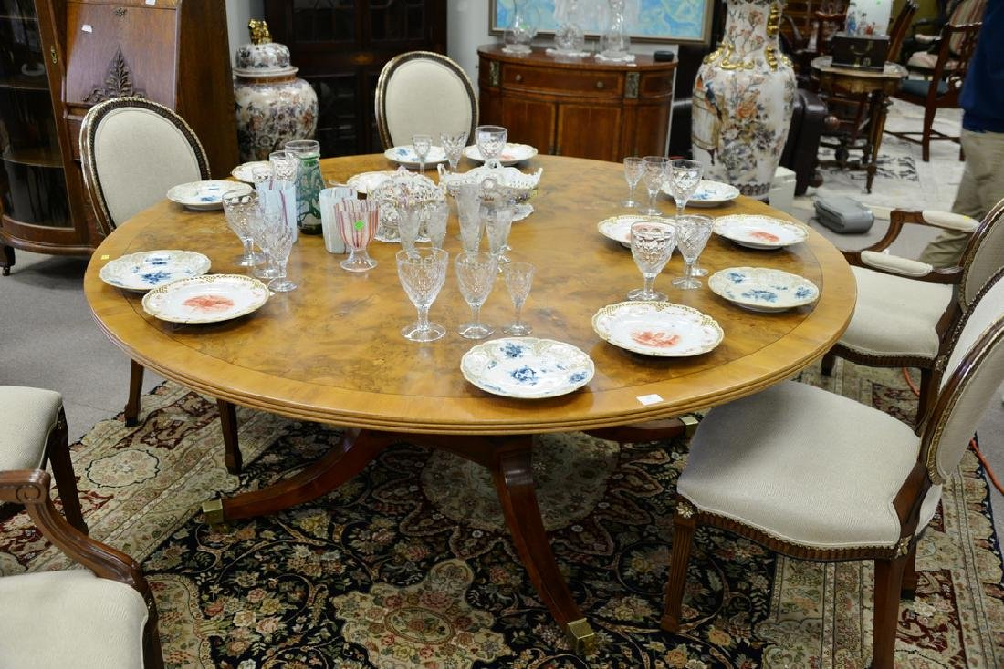 Round pedestal dining table with pads. ht. 29 in., dia. - 2