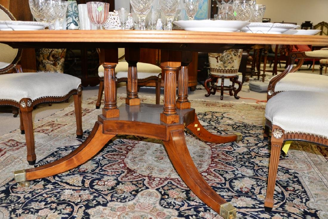 Round pedestal dining table with pads. ht. 29 in., dia. - 3