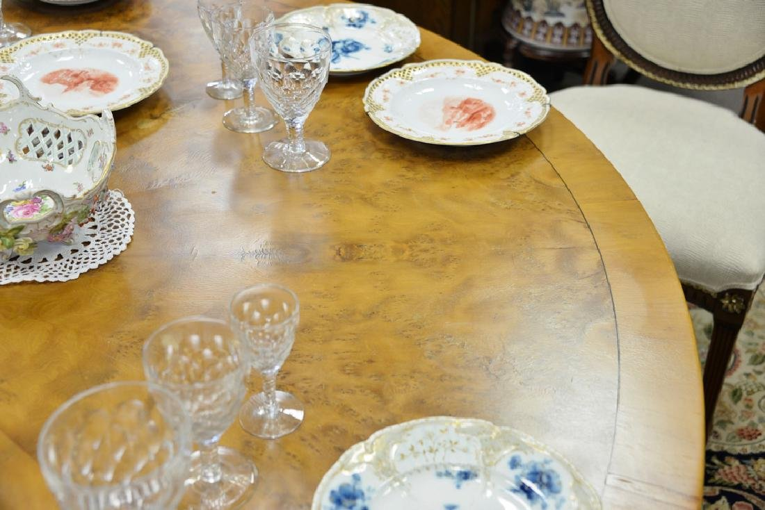 Round pedestal dining table with pads. ht. 29 in., dia. - 5