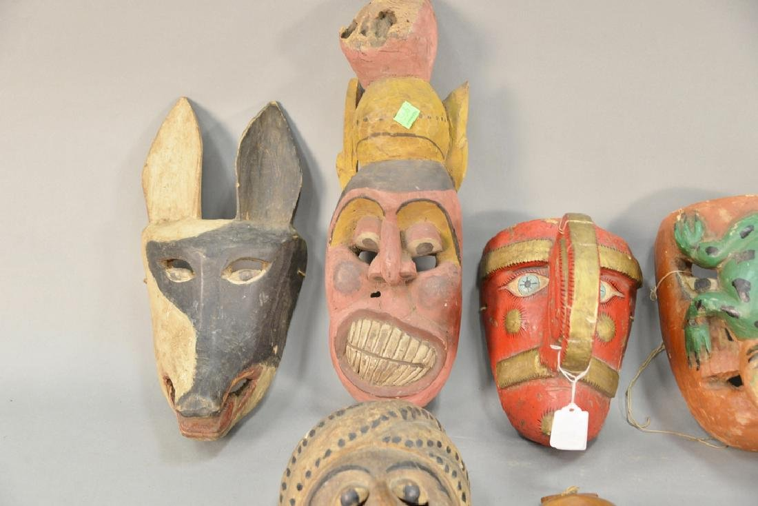 Eight wooden hand carved tribal masks to include a - 2