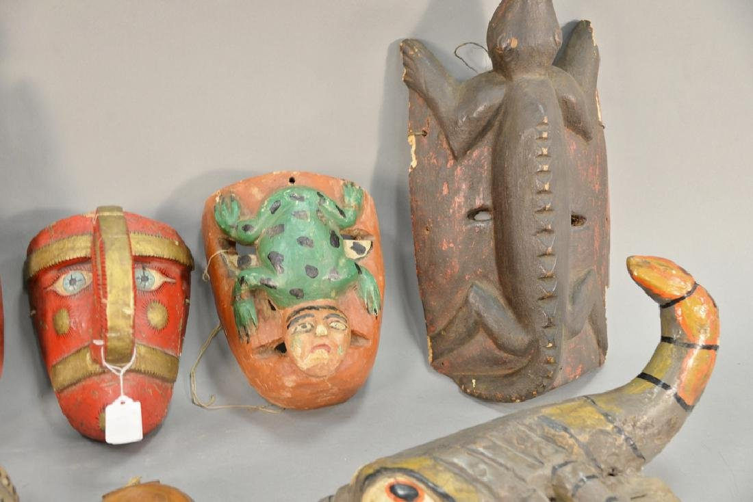 Eight wooden hand carved tribal masks to include a - 3