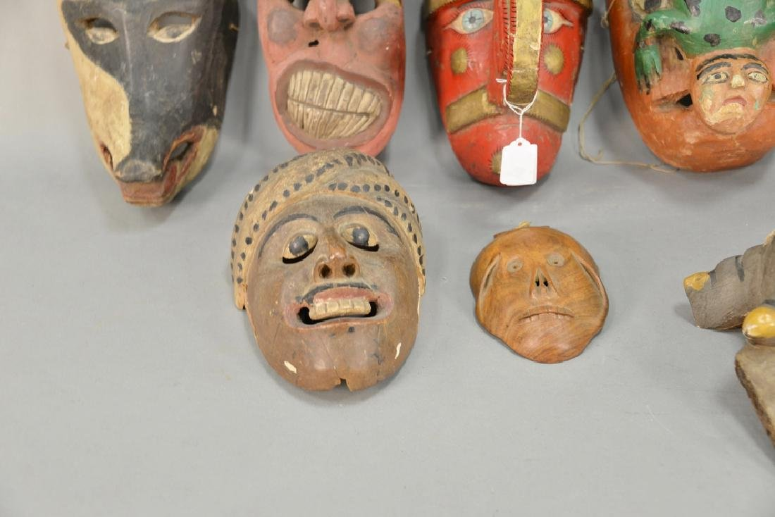 Eight wooden hand carved tribal masks to include a - 4