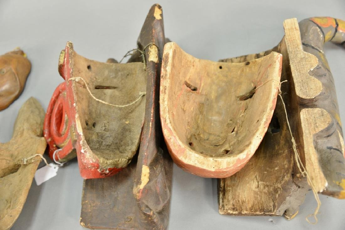Eight wooden hand carved tribal masks to include a - 7