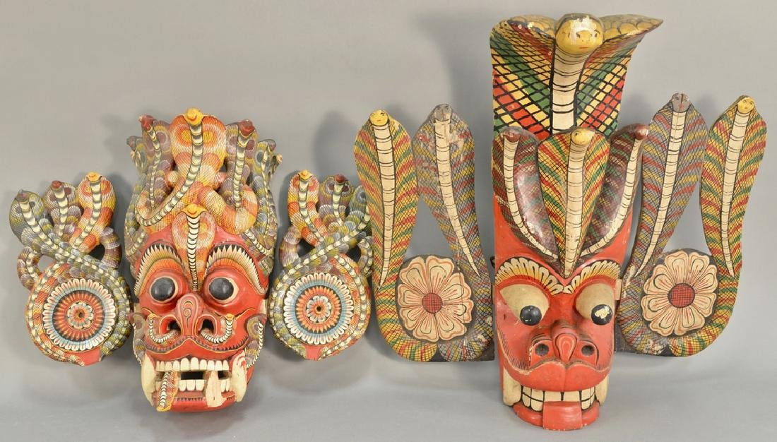 Two carved wood painted cobra snake headdress mask