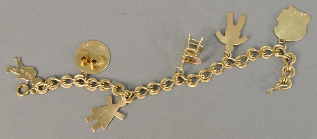 14 karat gold charm bracelet with 14 karat gold charms.