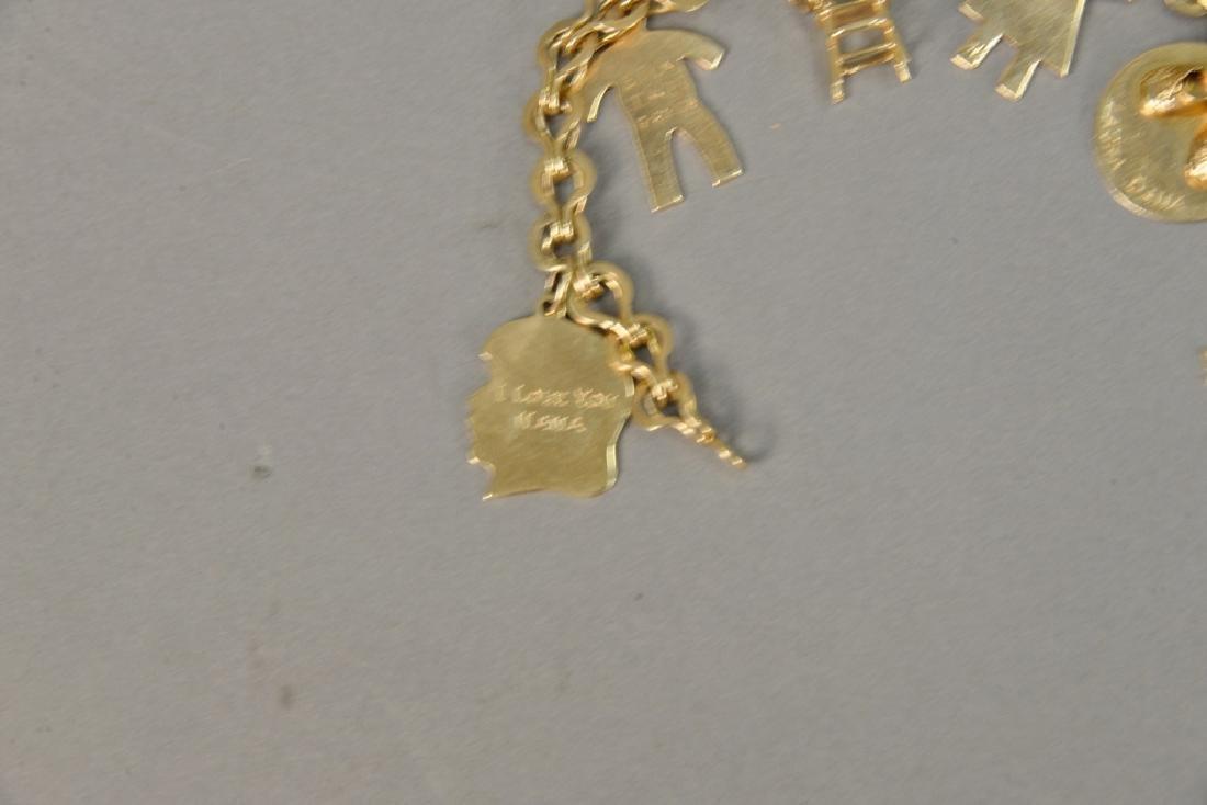 14 karat gold charm bracelet with 14 karat gold charms. - 2