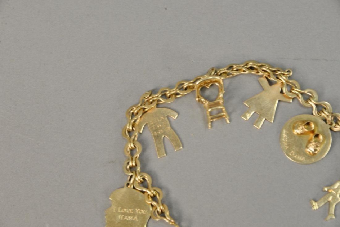 14 karat gold charm bracelet with 14 karat gold charms. - 3