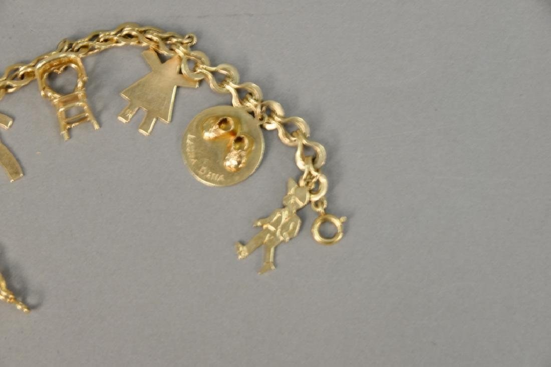 14 karat gold charm bracelet with 14 karat gold charms. - 4