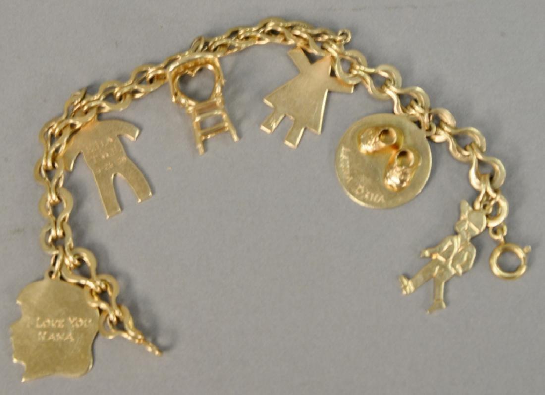 14 karat gold charm bracelet with 14 karat gold charms. - 5
