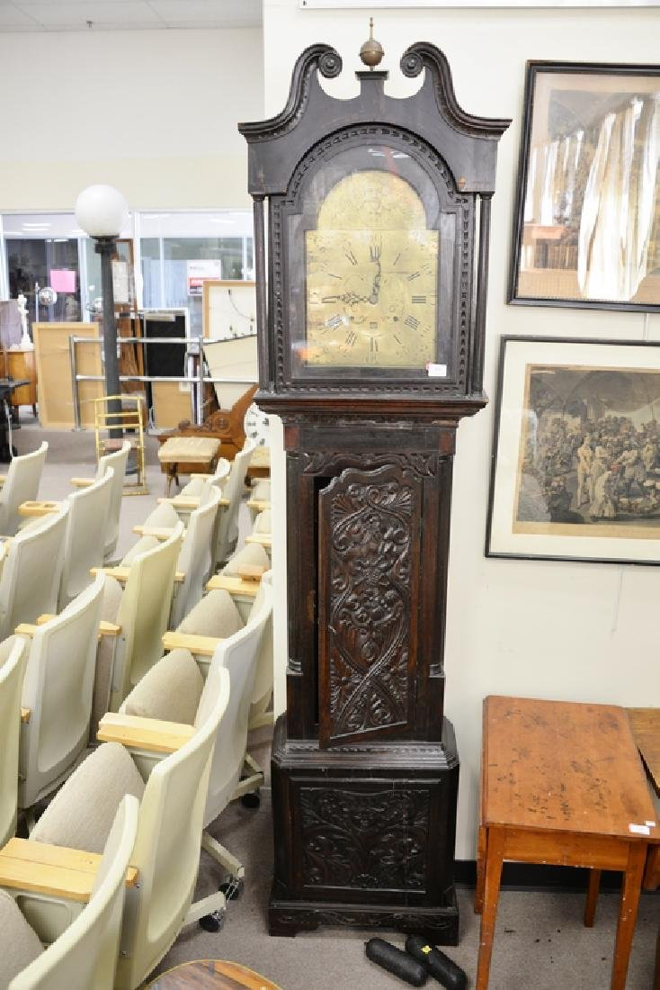 English oak tall clock with carved door and base, - 2