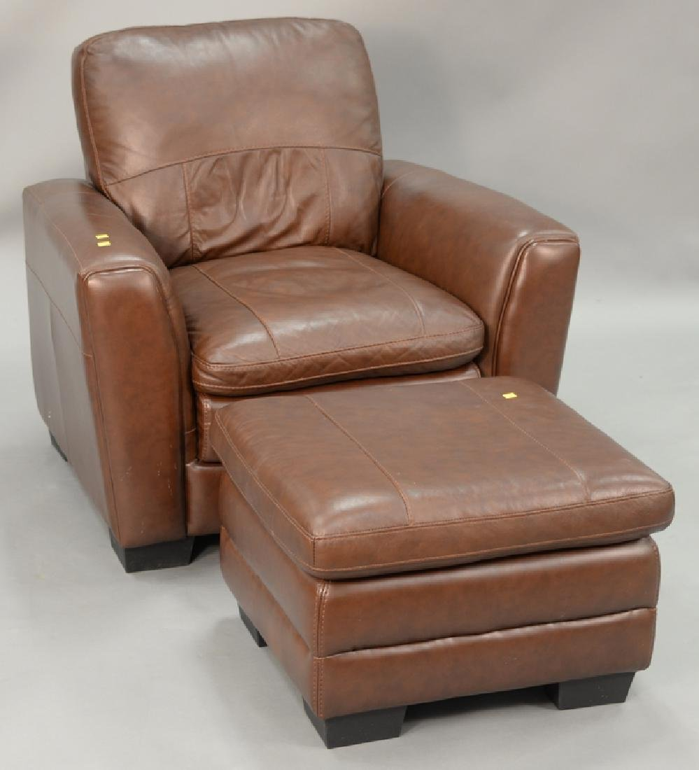 Leather easy chair and ottoman.