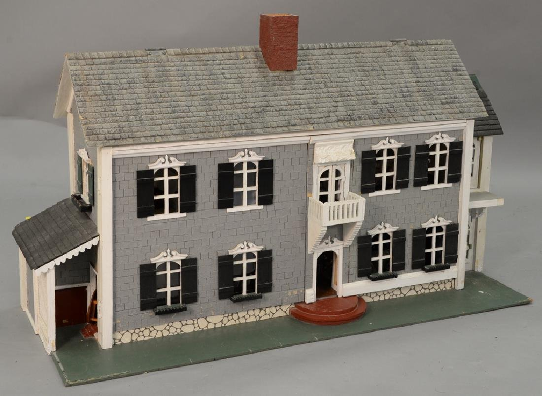 Dollhouse and furnishings. ht. 30 in., lg. 30 in., wd.