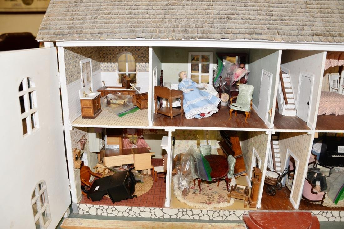 Dollhouse and furnishings. ht. 30 in., lg. 30 in., wd. - 3