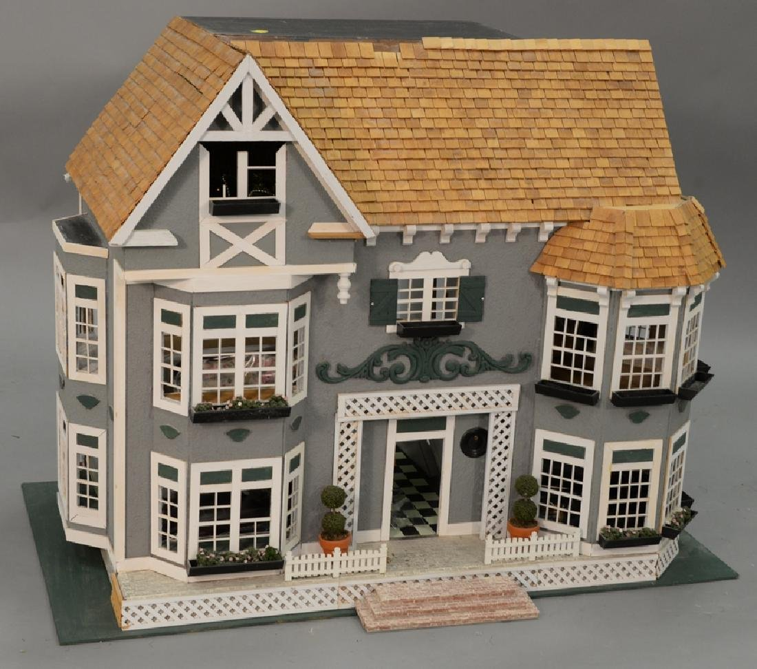 Doll house with furnishings. ht. 31 in., wd. 40 in.,