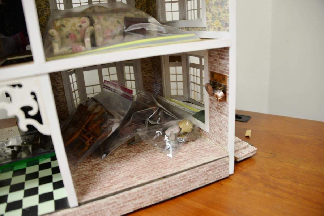 Doll house with furnishings. ht. 31 in., wd. 40 in., - 5