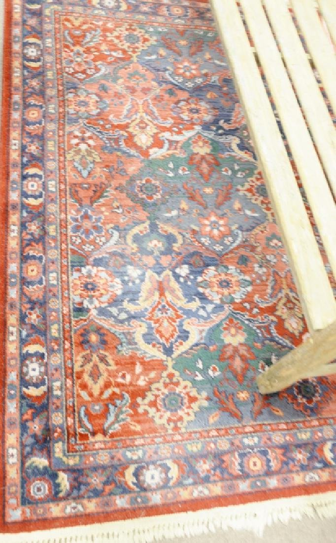 Three Oriental rugs to include an area rug and two