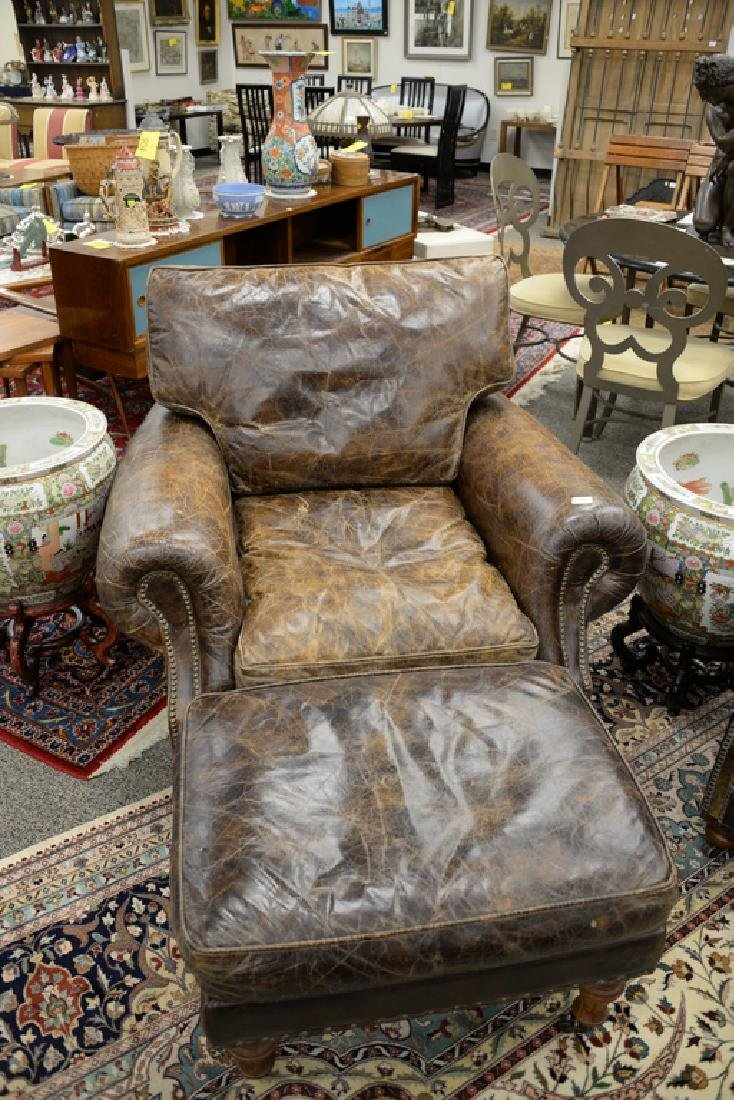 Leather upholstered chair and ottoman. ht. 34 in., wd. - 2