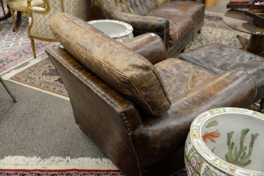 Leather upholstered chair and ottoman. ht. 34 in., wd. - 3