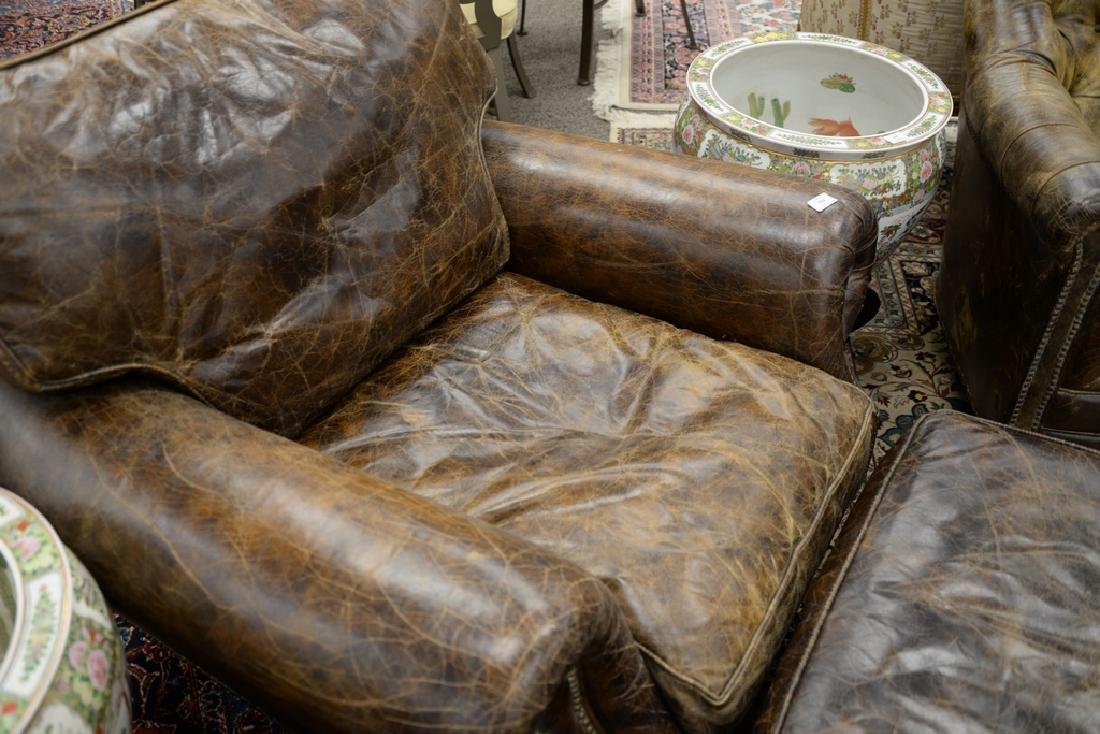 Leather upholstered chair and ottoman. ht. 34 in., wd. - 4
