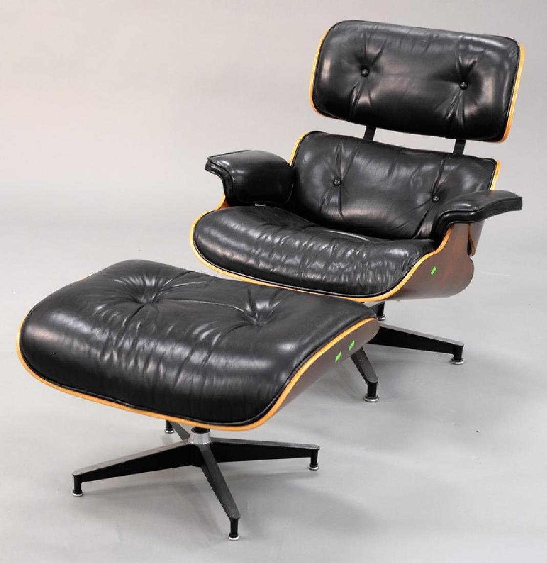 Herman Miller leather lounge chair and ottoman, signed.