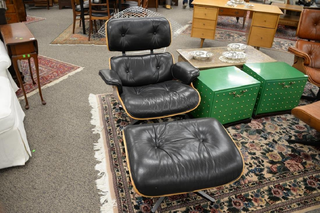 Herman Miller leather lounge chair and ottoman, signed. - 2