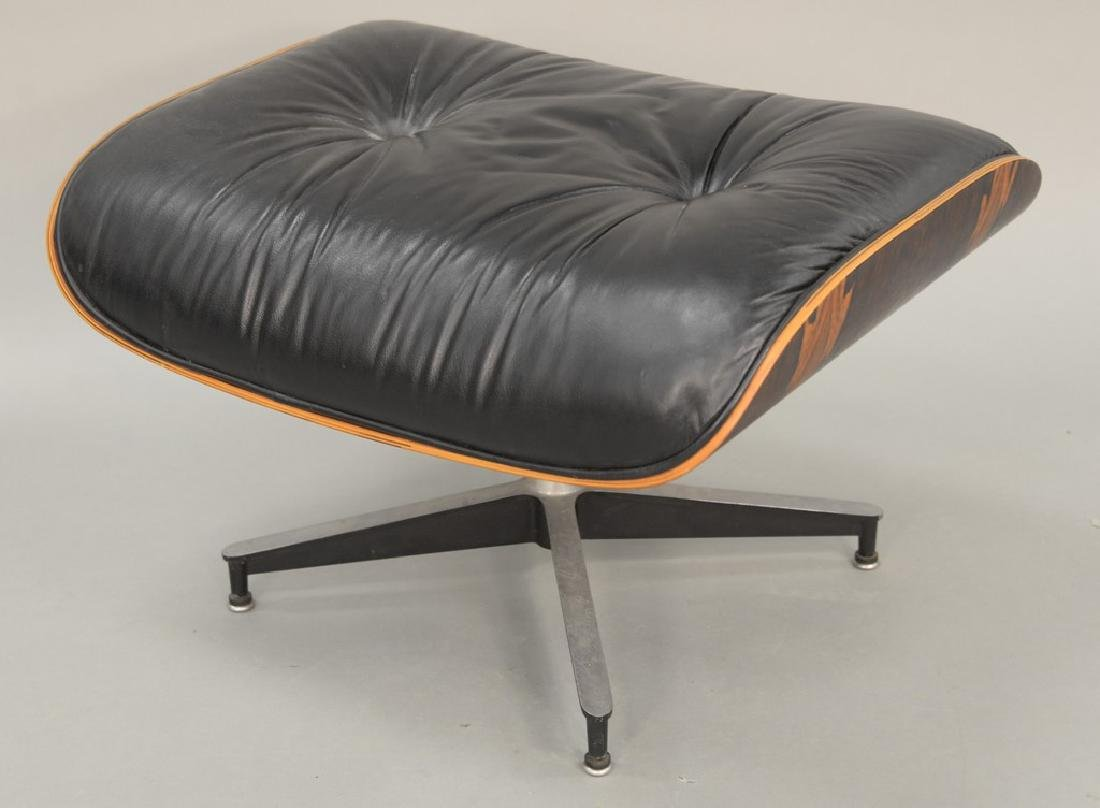 Eames chair ottoman, leather and rosewood.