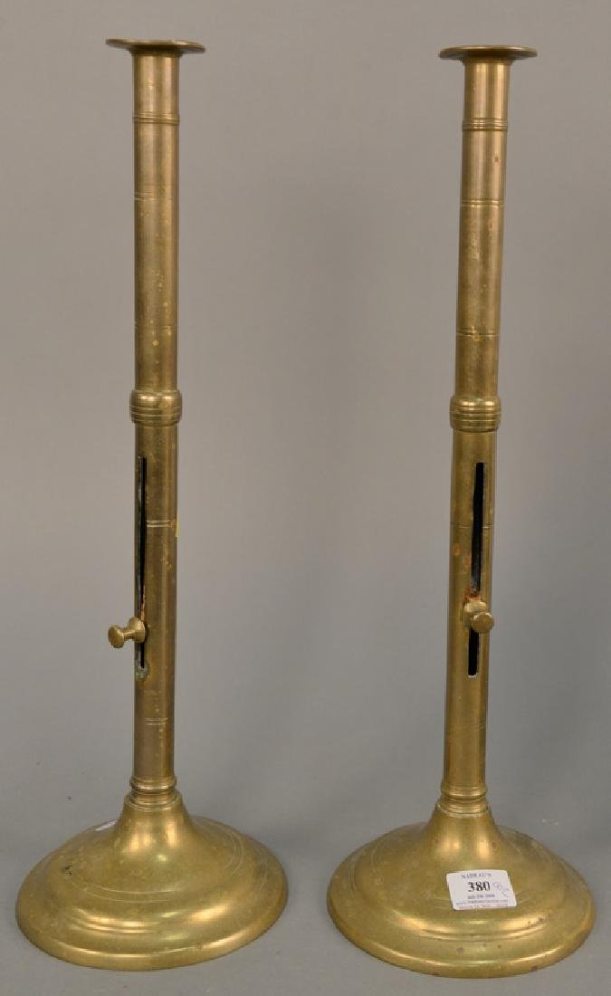 Pair of large brass push up candlesticks, ht. 20 in.