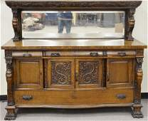 Carved oak two part sideboard with winged gargoyles and