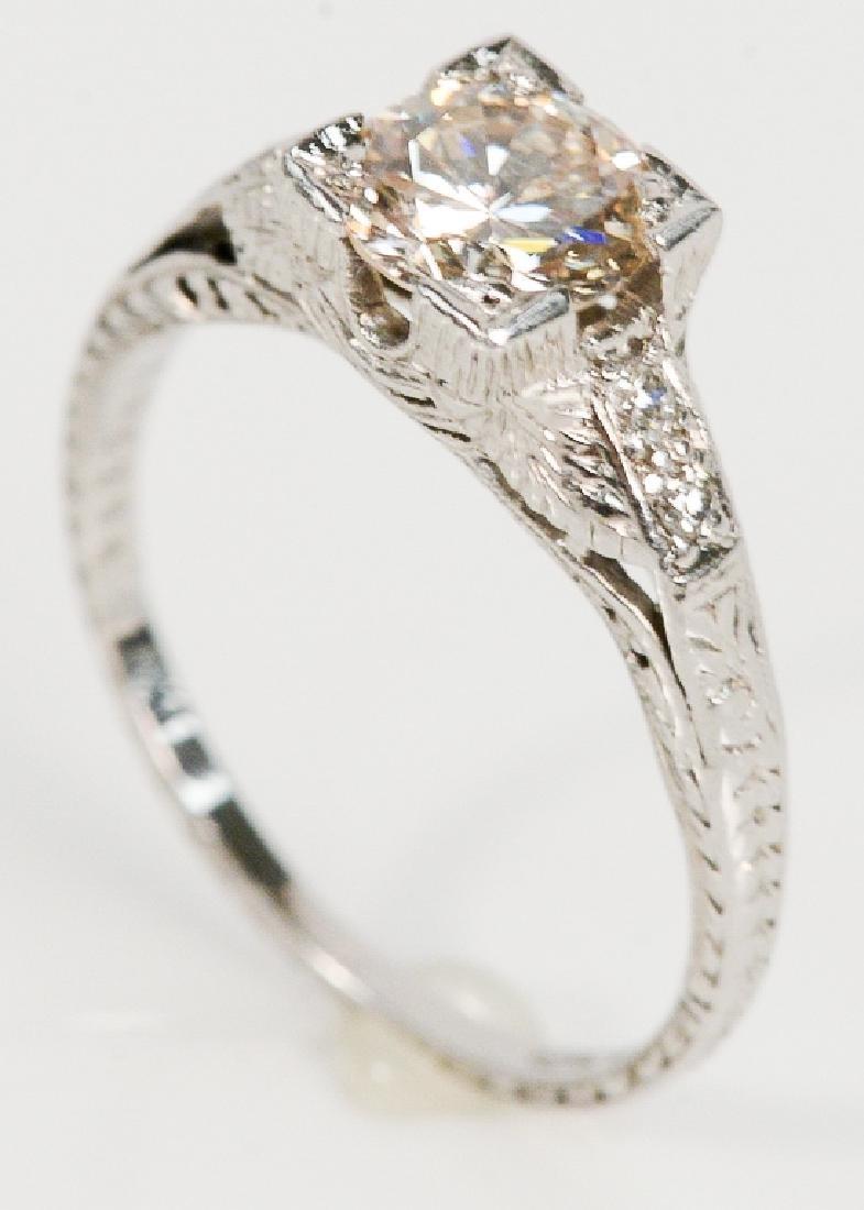 Platinum and diamond engagement ring having center