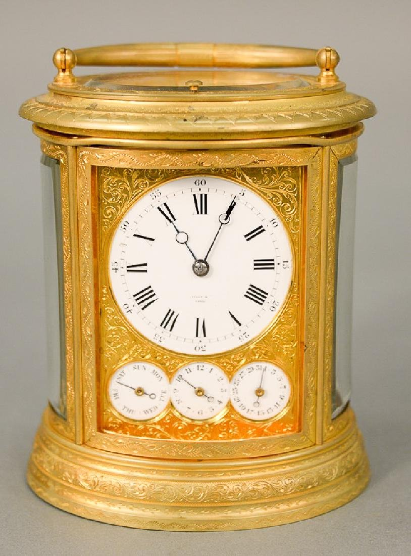 Oval Tiffany & Co. carriage clock, white enameled dial