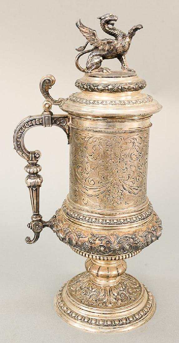 Continental silver tankard with winged griffin finial,