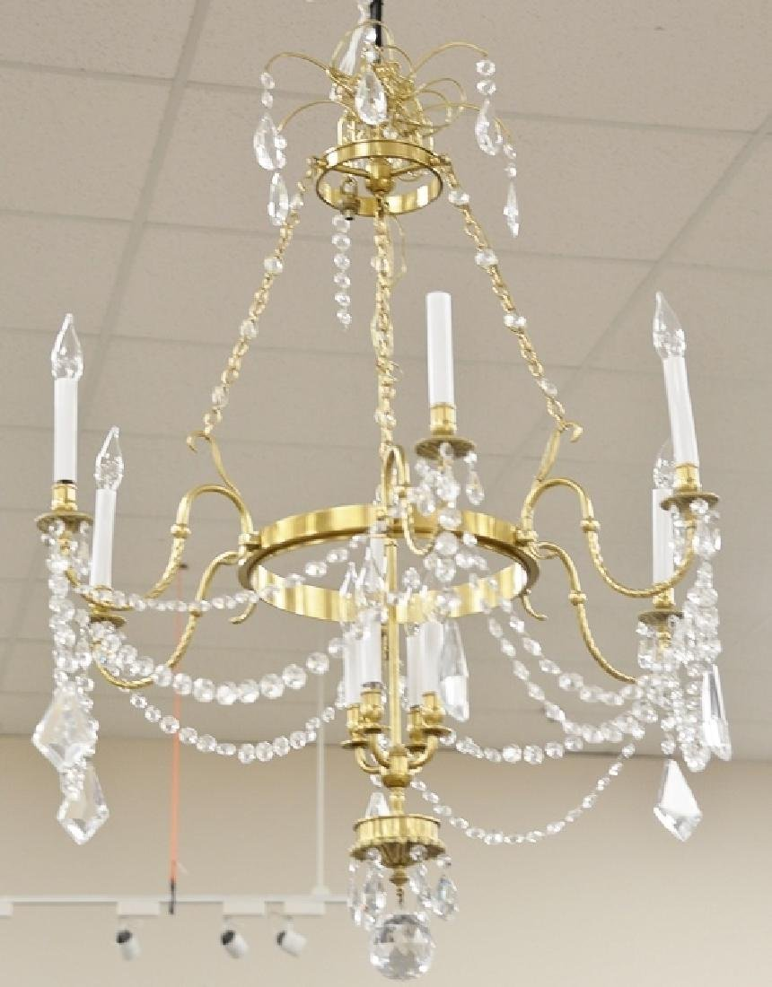 Contemporary chandelier, brass and crystal. approximate