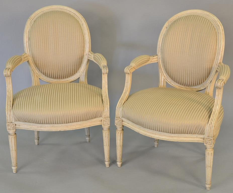 Pair of Louis XVI style cream painted fauteuils having