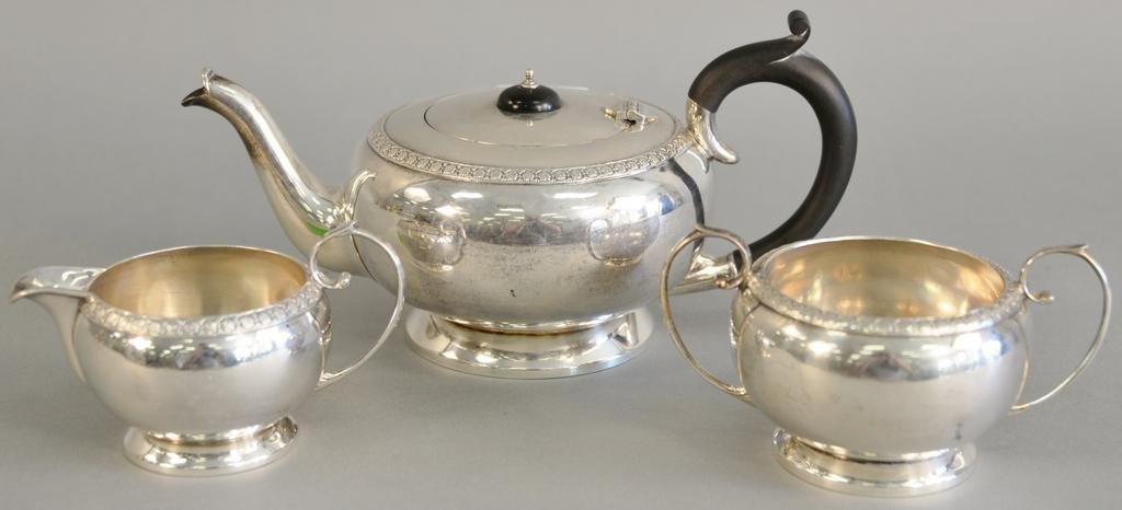 English silver three piece tea set with tea pot, sugar