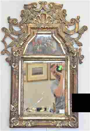 Large courting type mirror having gilt open work over