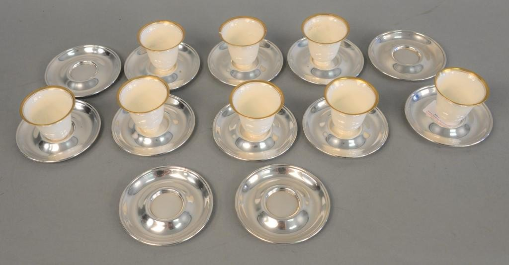 Set of twelve American silver circular saucers mark of