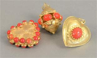 Three large 18K gold charms with red stones, 35.7 grams