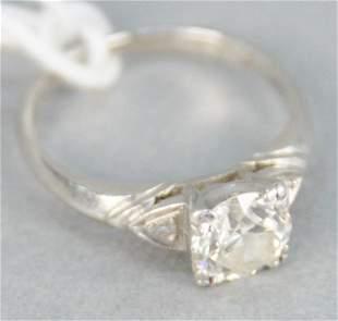 Platinum and diamond ring, with center diamond