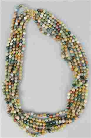 Beaded necklace, six strands with 14K gold clasp.
