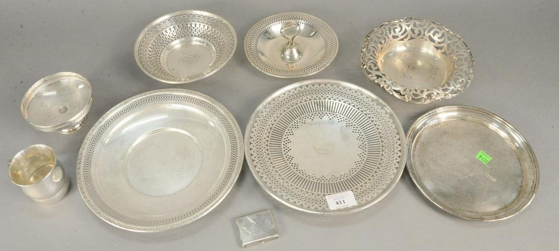 Nine piece sterling silver lot with plates and cups.