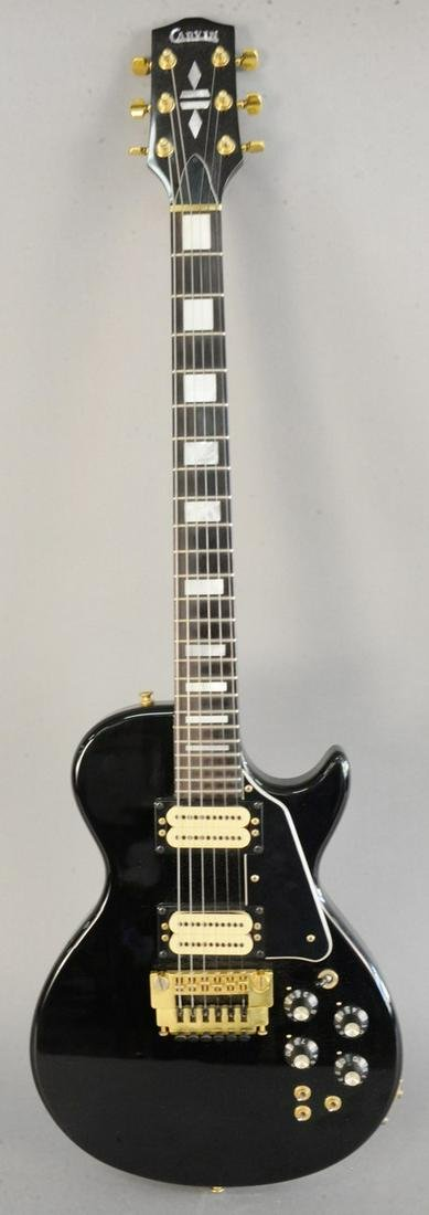 Carvin electric guitar, having a black body and six